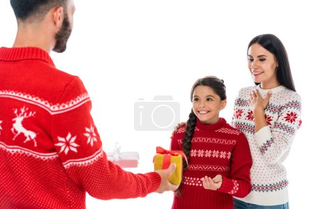 Photo pour Bearded man giving presents to wife and daughter isolated on white - image libre de droit