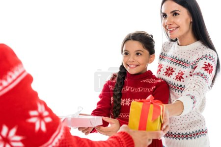 Photo pour Cropped view of man giving presents to wife and daughter isolated on white - image libre de droit