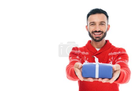 selective focus of happy bearded man holding present isolated on white