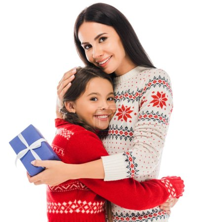 Photo pour Happy mother hugging daughter and holding preset isolated on white - image libre de droit