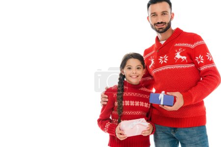 Photo pour Happy father and cheerful daughter holding christmas presents isolated on white - image libre de droit