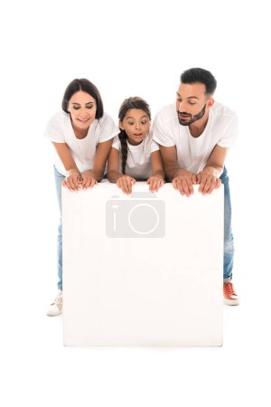 Photo for Happy family standing near blank placard isolated on white - Royalty Free Image