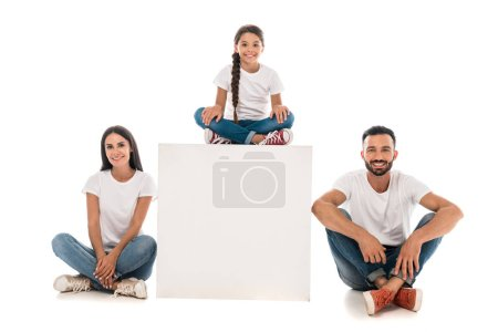 Photo for Happy kid sitting on cube near cheerful parents isolated on white - Royalty Free Image