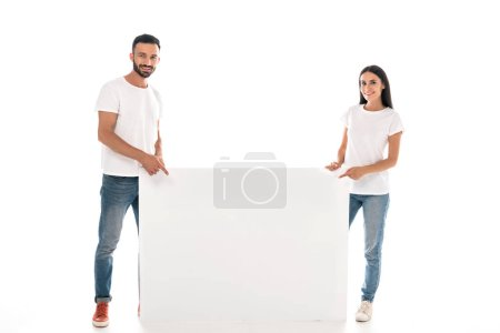 Photo for Happy bearded man and woman standing near blank placard isolated on white - Royalty Free Image