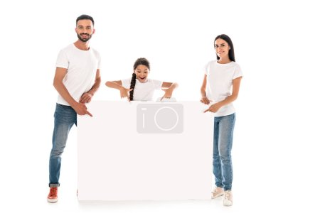 Photo for Happy parents and kid pointing with fingers at blank placard isolated on white - Royalty Free Image