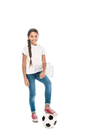 Photo for Happy kid standing with football and smiling isolated on white - Royalty Free Image