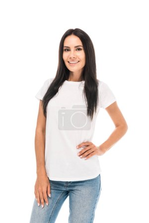 cheerful woman standing with hand in hip isolated on white