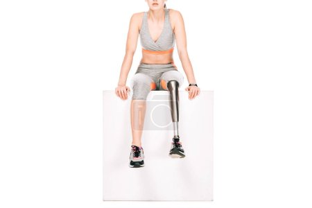 Photo for Partial view of disabled sportswoman with prosthetic leg isolated on white - Royalty Free Image