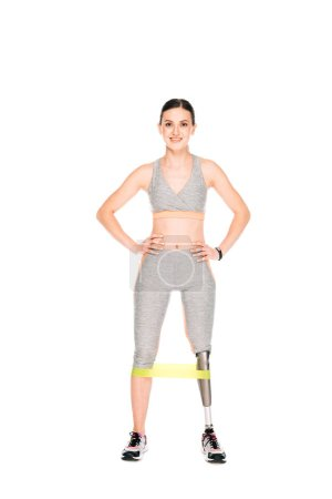 Photo for Full length view of smiling disabled sportswoman with resistance band isolated on white - Royalty Free Image