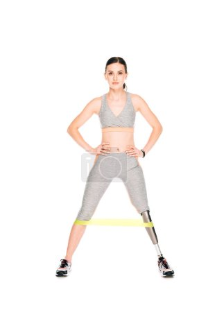 Photo for Full length view of disabled sportswoman with resistance band isolated on white - Royalty Free Image