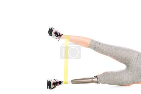 Photo pour Cropped view of disabled sportswoman with resistance band isolated on white - image libre de droit