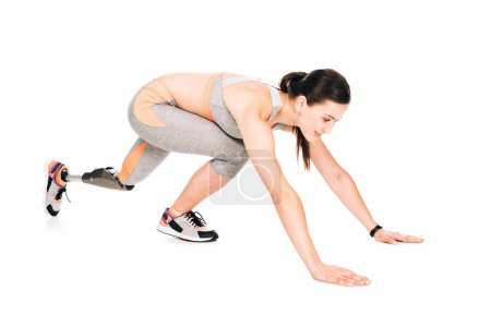 Photo for Disabled sportswoman with prosthesis training isolated on white - Royalty Free Image