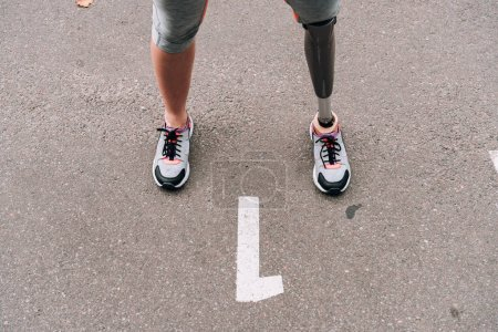 Photo for Partial view of disabled sportswoman with prosthesis on street - Royalty Free Image