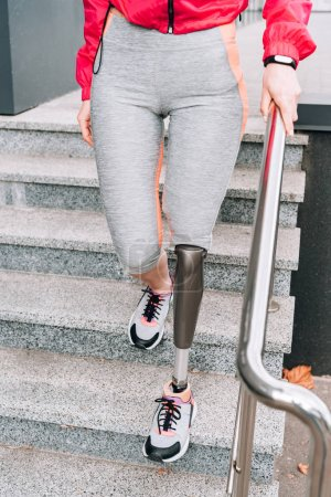 Photo for Cropped view of disabled sportswoman with prosthesis on stairs - Royalty Free Image