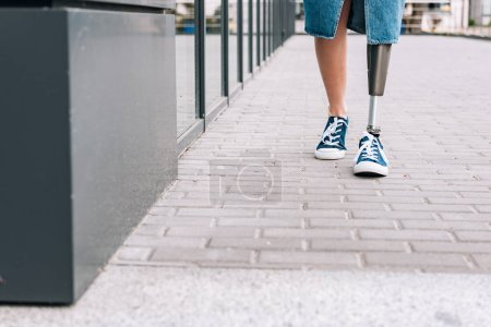 Photo for Cropped view of disabled woman with prosthetic leg on street - Royalty Free Image