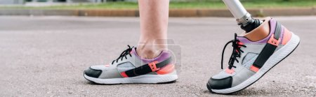 Photo for Panoramic shot of disabled sportswoman with prosthetic leg on street - Royalty Free Image