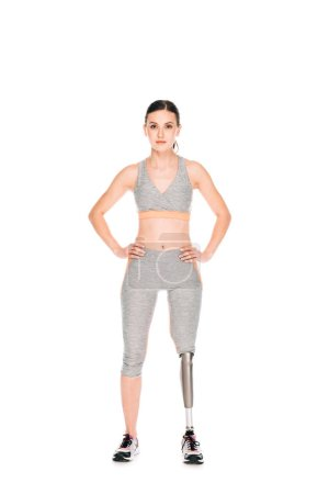 Photo for Full length view of disabled sportswoman standing with hands on hips isolated on white - Royalty Free Image