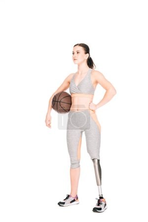 Photo for Full length view of disabled sportswoman holding basketball ball isolated on white - Royalty Free Image