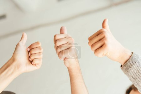 Photo for Cropped view of brokers showing thumbs up - Royalty Free Image