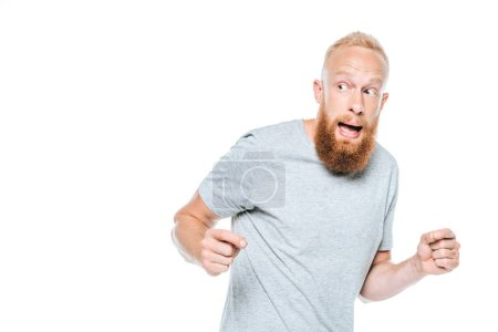 Photo for Handsome frightened bearded man in grey t-shirt, isolated on white - Royalty Free Image