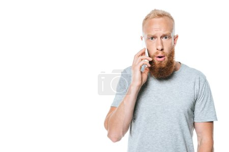 Foto de Shock bearded man talking on smartphone, isolated on white - Imagen libre de derechos