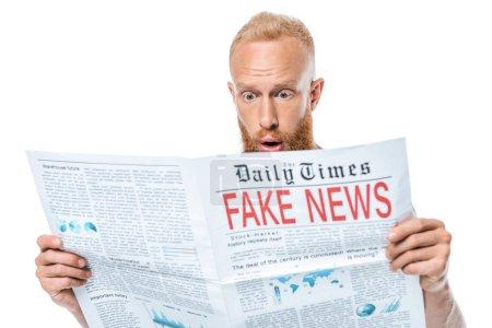 Photo pour Homme barbu surpris lire journal avec de fausses nouvelles, isolé sur blanc - image libre de droit