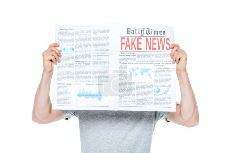 Photo for Man reading newspaper with fake news, isolated on white - Royalty Free Image