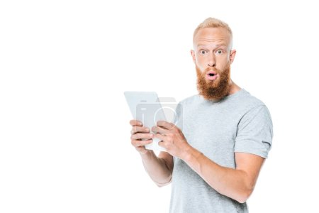 handsome shocked man using digital tablet, isolated on white