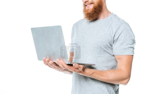 Photo for Cropped view of smiling bearded man using laptop, isolated on white - Royalty Free Image
