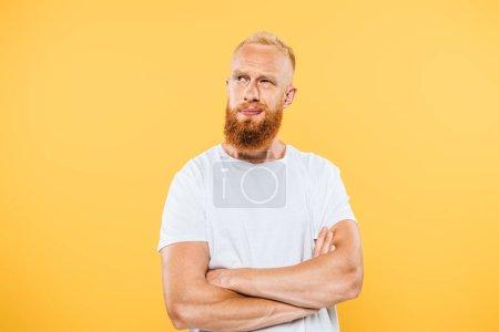 Foto de Retrato del hombre pensivo, aislado en amarillo - Imagen libre de derechos
