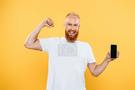 successful man showing smartphone with blank screen, isolated on yellow