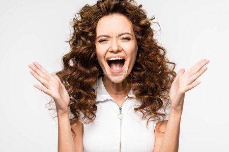 Photo for Excited curly girl screaming in white t-shirt, isolated on white - Royalty Free Image