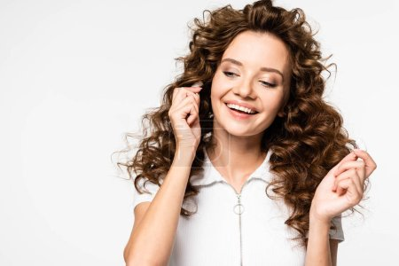 Photo for Attractive happy girl listening music with wireless earphones, isolated on white - Royalty Free Image
