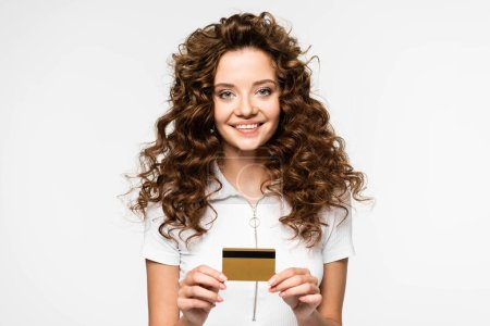 beautiful curly young woman holding credit card, isolated on white