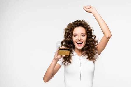 beautiful excited girl holding credit card, isolated on white
