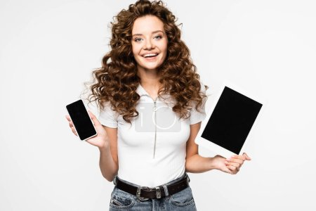 Photo for Attractive woman showing smartphone and digital tablet with blank screens, isolated on white - Royalty Free Image