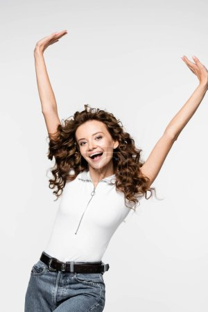 Photo for Excited curly young woman in white t-shirt, isolated on white - Royalty Free Image
