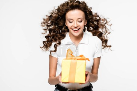 attractive excited girl holding gift, isolated on white