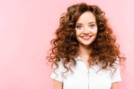 Photo for Beautiful smiling curly girl, isolated on pink - Royalty Free Image