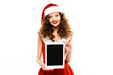Photo for Cheerful girl in santa costume showing digital tablet with blank screen, isolated on white - Royalty Free Image