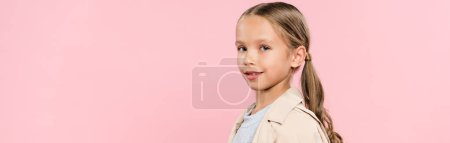 Photo for Panoramic shot of smiling kid looking at camera isolated on pink - Royalty Free Image
