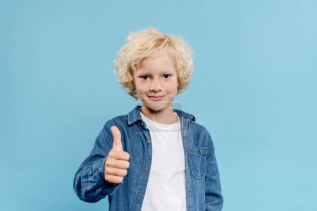 Photo for Smiling and cute kid looking at camera and showing like isolated on blue - Royalty Free Image