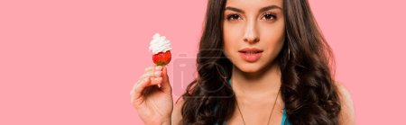Photo for Panoramic shot of woman holding strawberry with whipped cream isolated on pink - Royalty Free Image