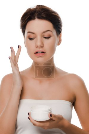 Photo for Woman with face cream on finger holding container isolated on white - Royalty Free Image