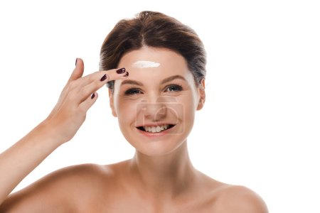 Photo pour Happy naked girl applying face cream isolated on white - image libre de droit