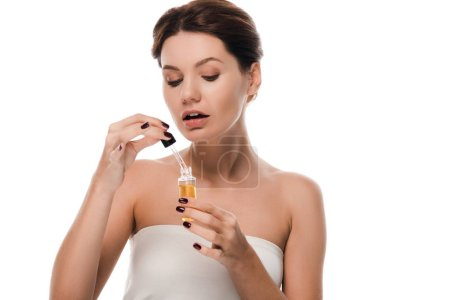Photo pour Attractive woman holding pipette with serum isolated on white - image libre de droit
