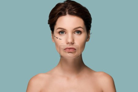Photo pour Attractive woman with marked lines on face isolated on blue - image libre de droit