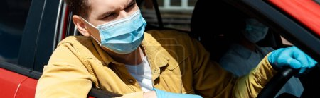 Photo for Man in medical mask and protective gloves driving taxi during coronavirus pandemic, website header - Royalty Free Image