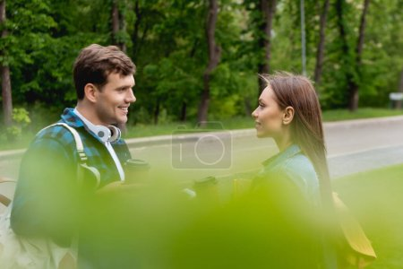 Photo for Selective focus of cheerful and young students looking at each other - Royalty Free Image