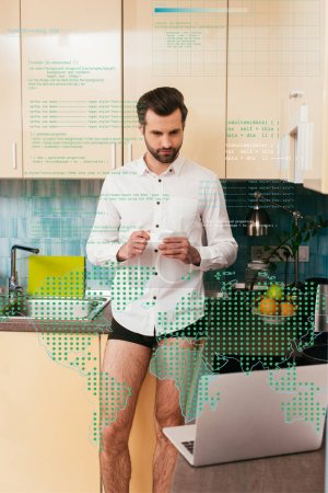 Photo for Selective focus of handsome man in panties and shirt looking at laptop while drinking coffee in kitchen, digital illustration - Royalty Free Image